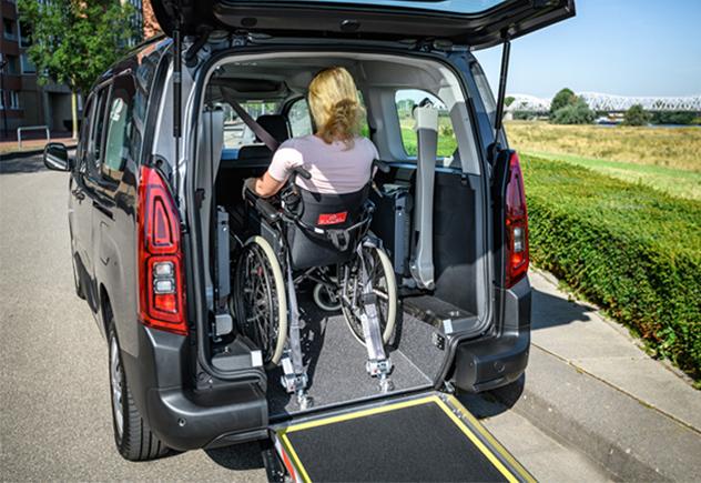 Women getting into wheelchair van